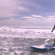 Kimi Ora Surfing